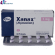 White backgrounded image of a xanax or alprazolam bars/pills