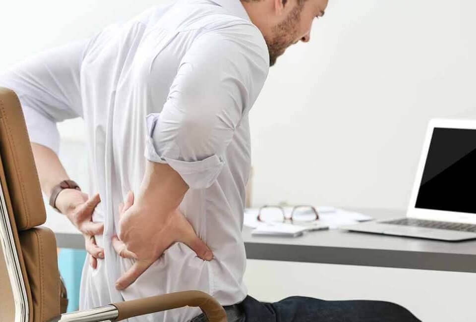 Men holding his back due to pain